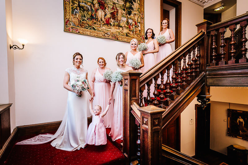 Bridesmaids on stairwell